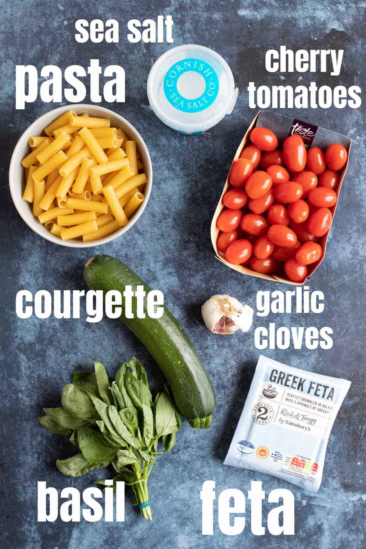 Ingredients for baked feta pasta with courgettes and tomatoes.