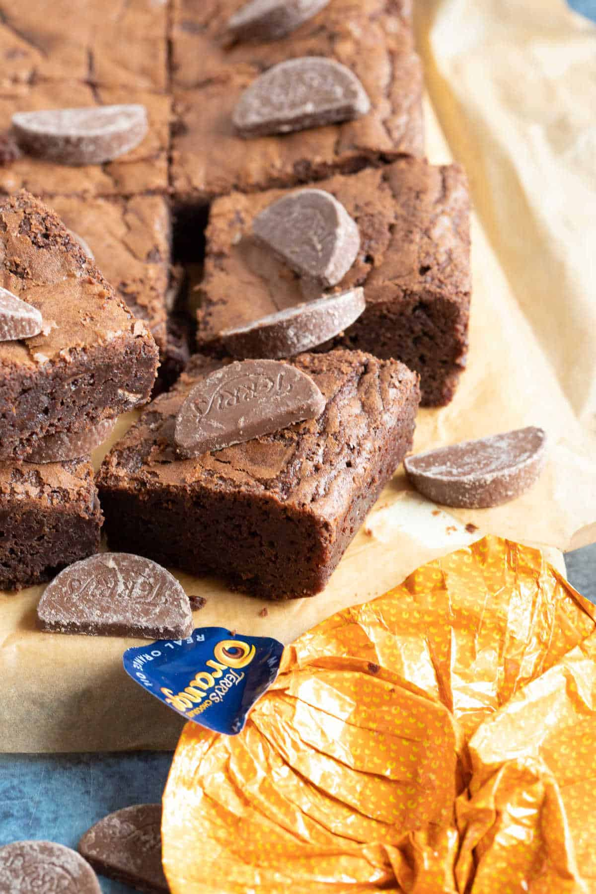 Terry's chocolate orange brownies cut into bars and topped with chocolate orange minis.