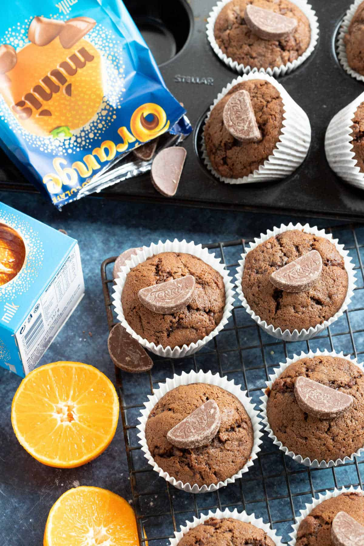 Chocolate orange muffins on a cooling rack.