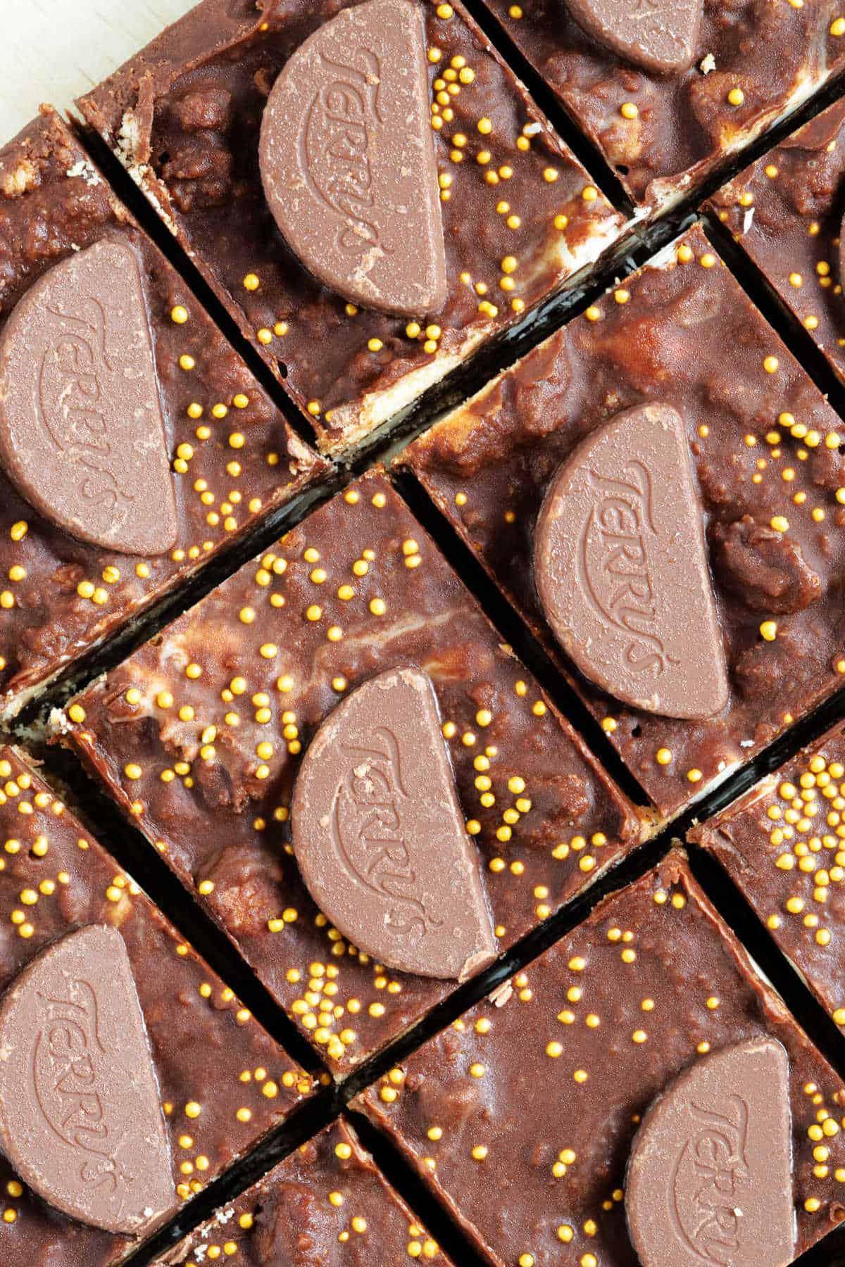 Sliced chocolate orange tiffin topped with chocolate orange minis.