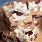 A stack of cranberry white chocolate blondies.