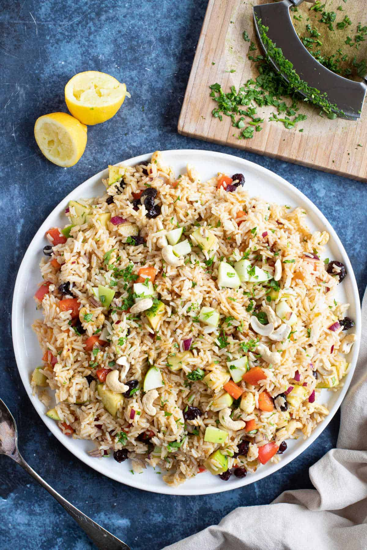 Curried rice salad on a white serving platter.