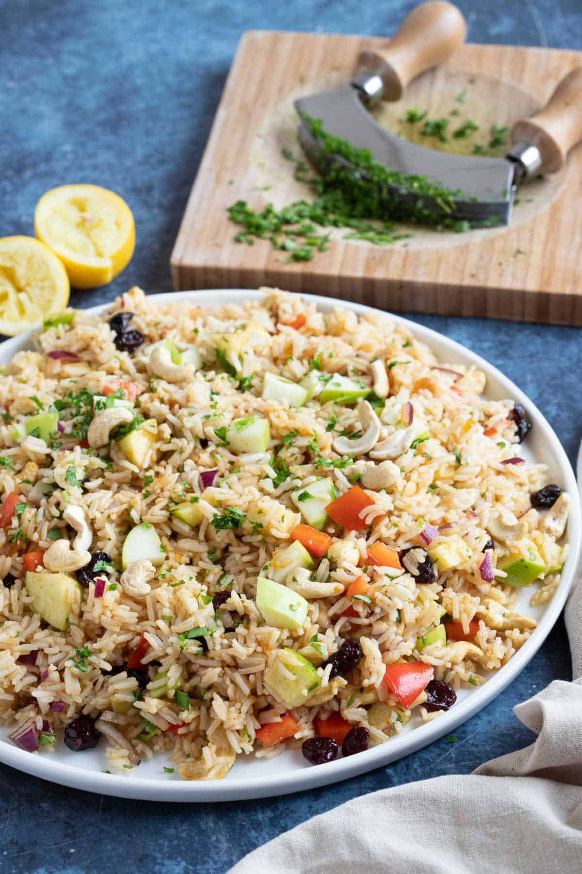 Easy curried rice salad garnished with parsley.