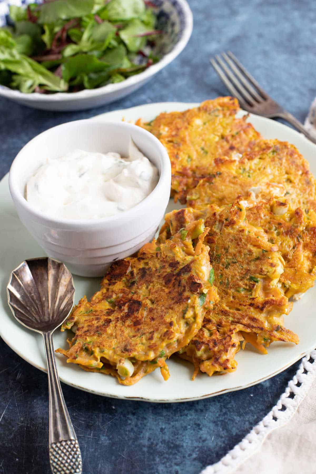 Easy carrot fritters with a sour cream dip and salad.