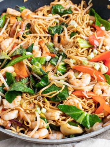 Prawn chow mein in a wok.
