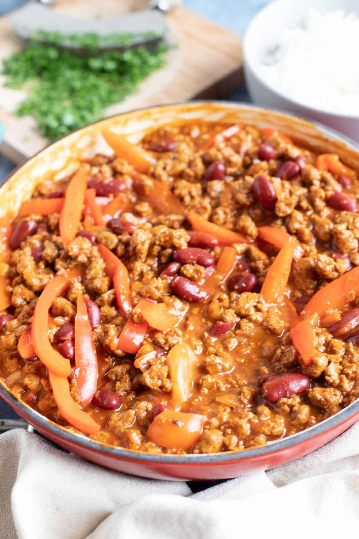 Quorn chilli con carne in a red pan.