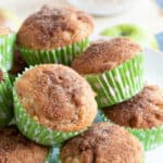 Easy cinnamon apple muffins on a cake stand.