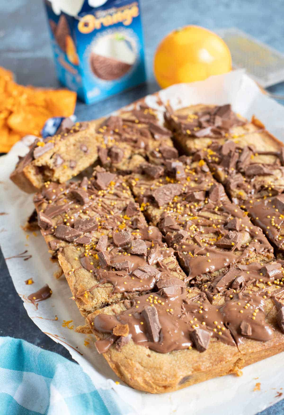 Chocolate orange cookie bars cut into squares on a board.