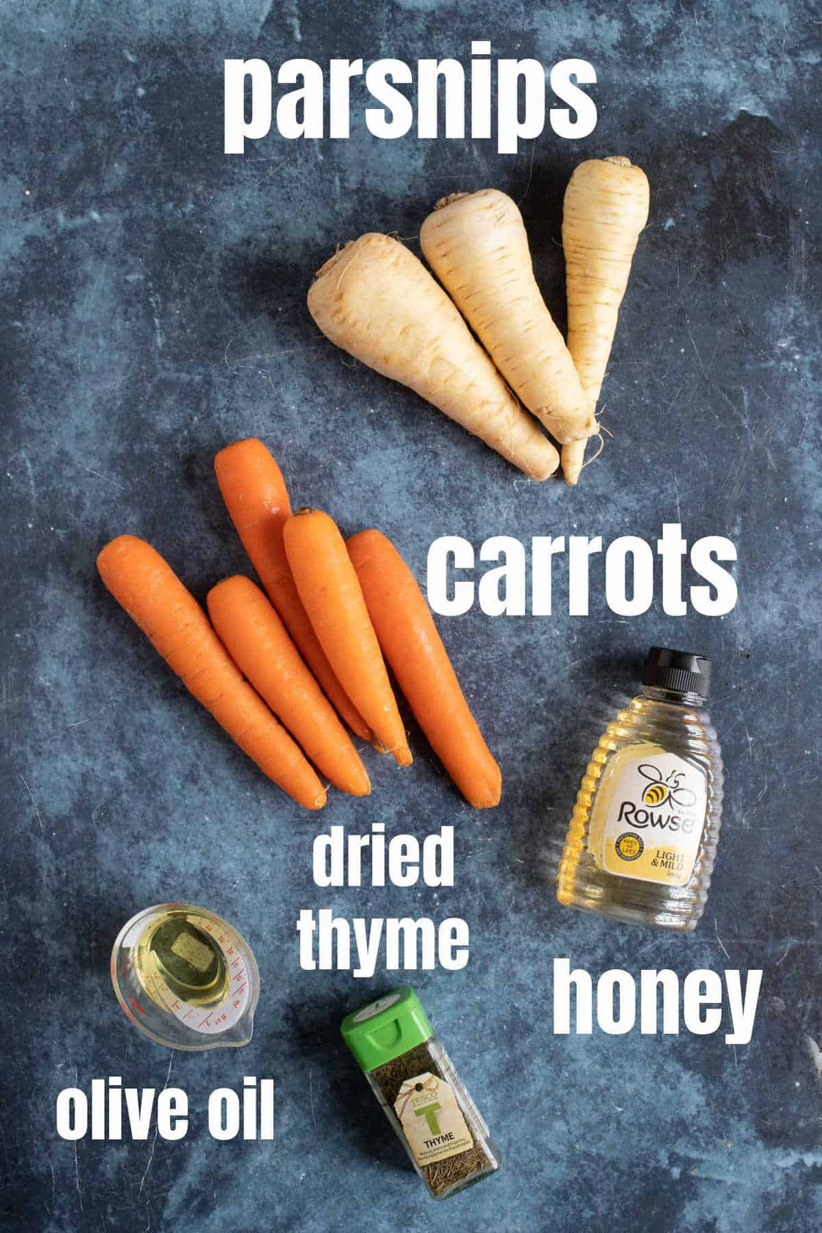 Ingredients needed for honey roasted carrots and parsnips.
