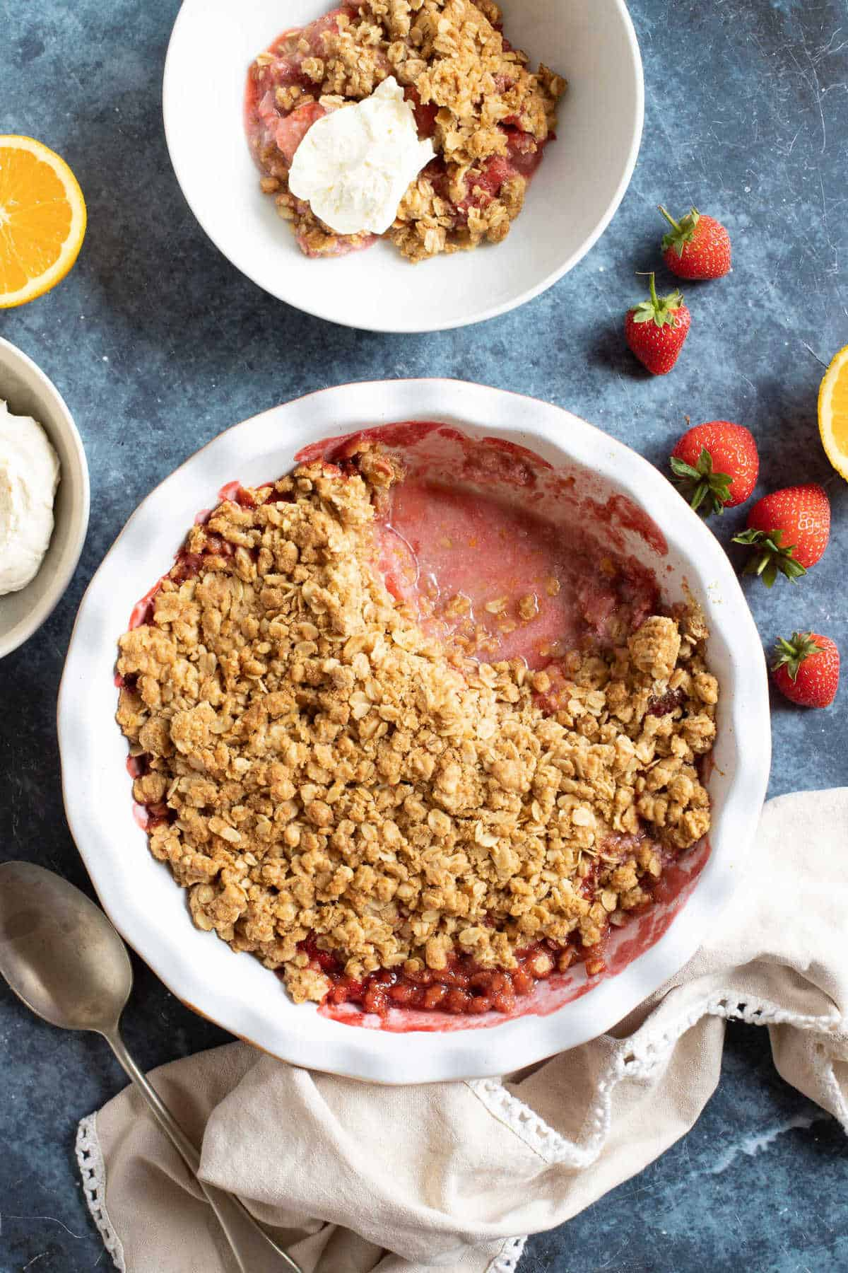 Strawberry crumble served with whipped cream.