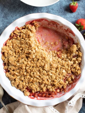 Strawberry crumble in a pie dish.