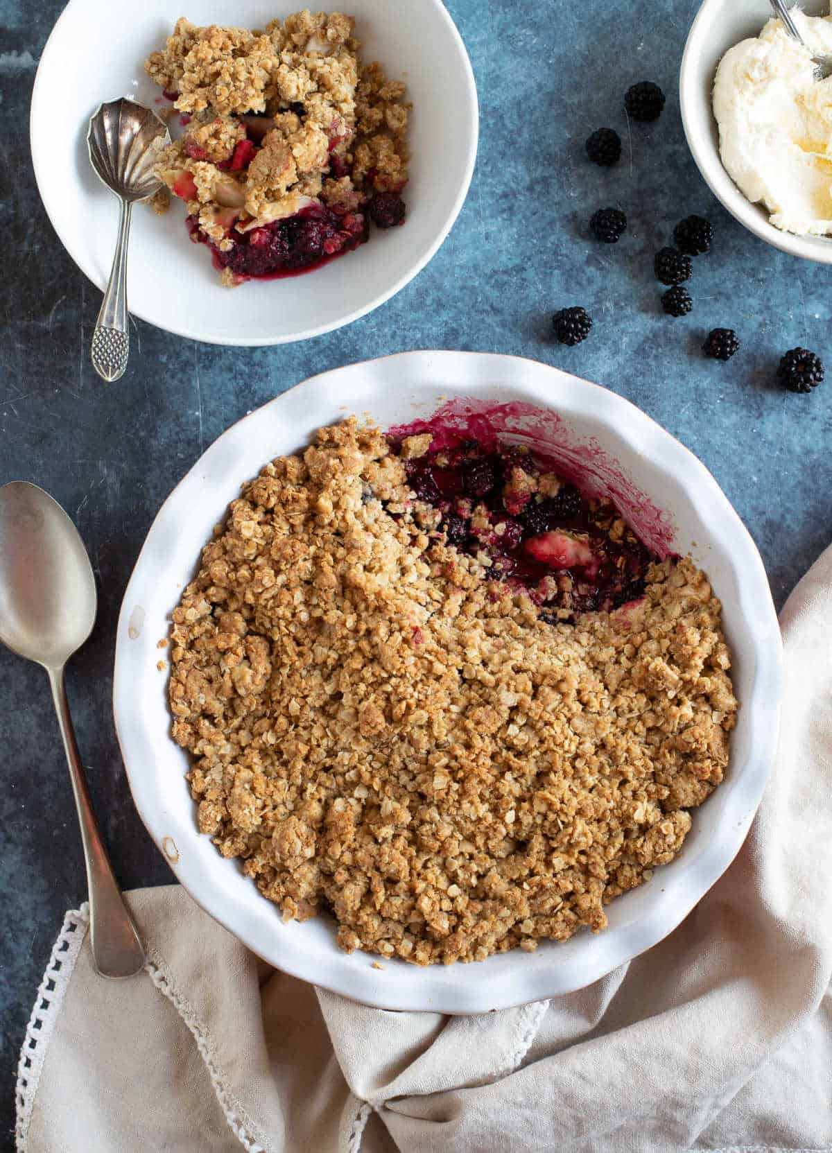 Blackberry crumble with whipped cream.