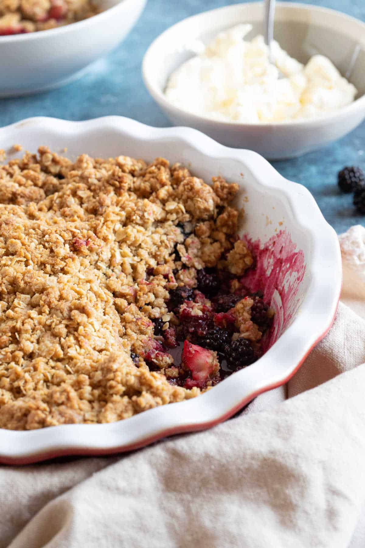 Blackberry and apple crumble with cream.
