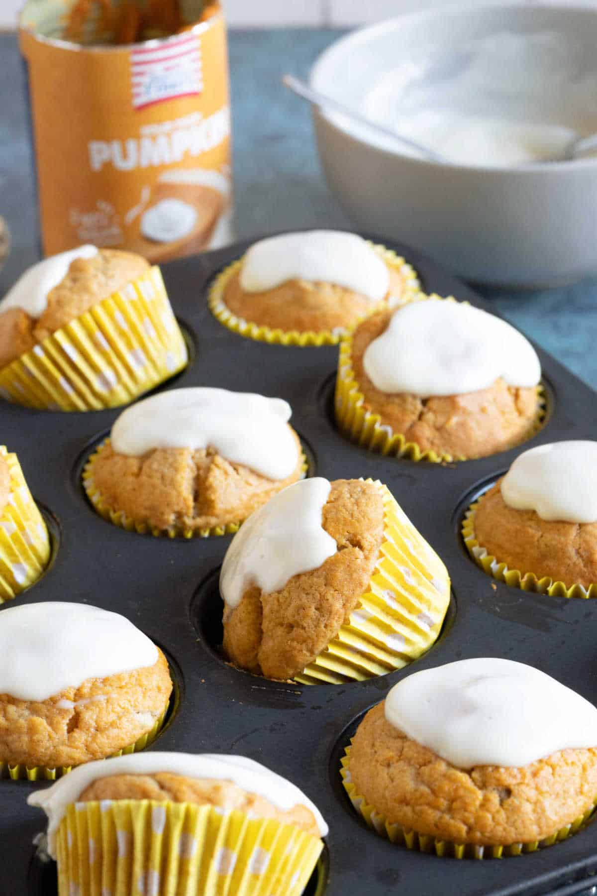 A stack of pumpkin muffins on a cake stand.