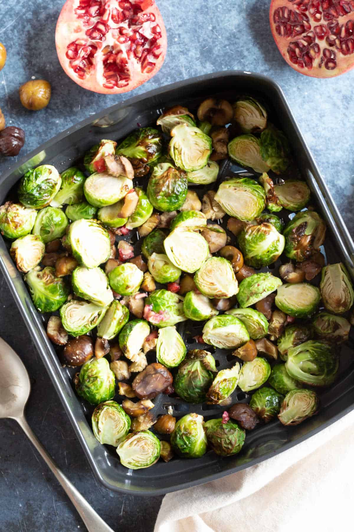 Brussels sprouts in the air fryer basket.