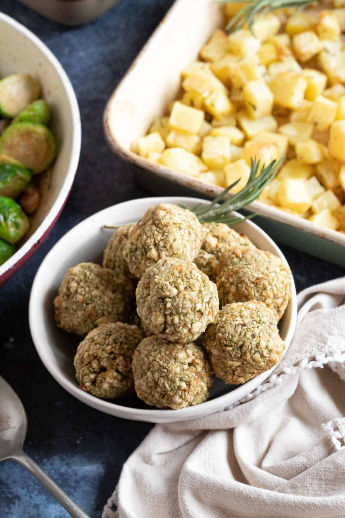 Air fryer sage and onion stuffing balls  with potatoes and brussels sprouts.