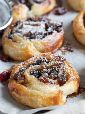 Mincemeat pinwheels dusted with icing sugar.