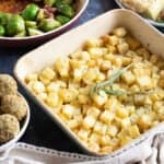 Parmentier potatoes in a roasting tin.