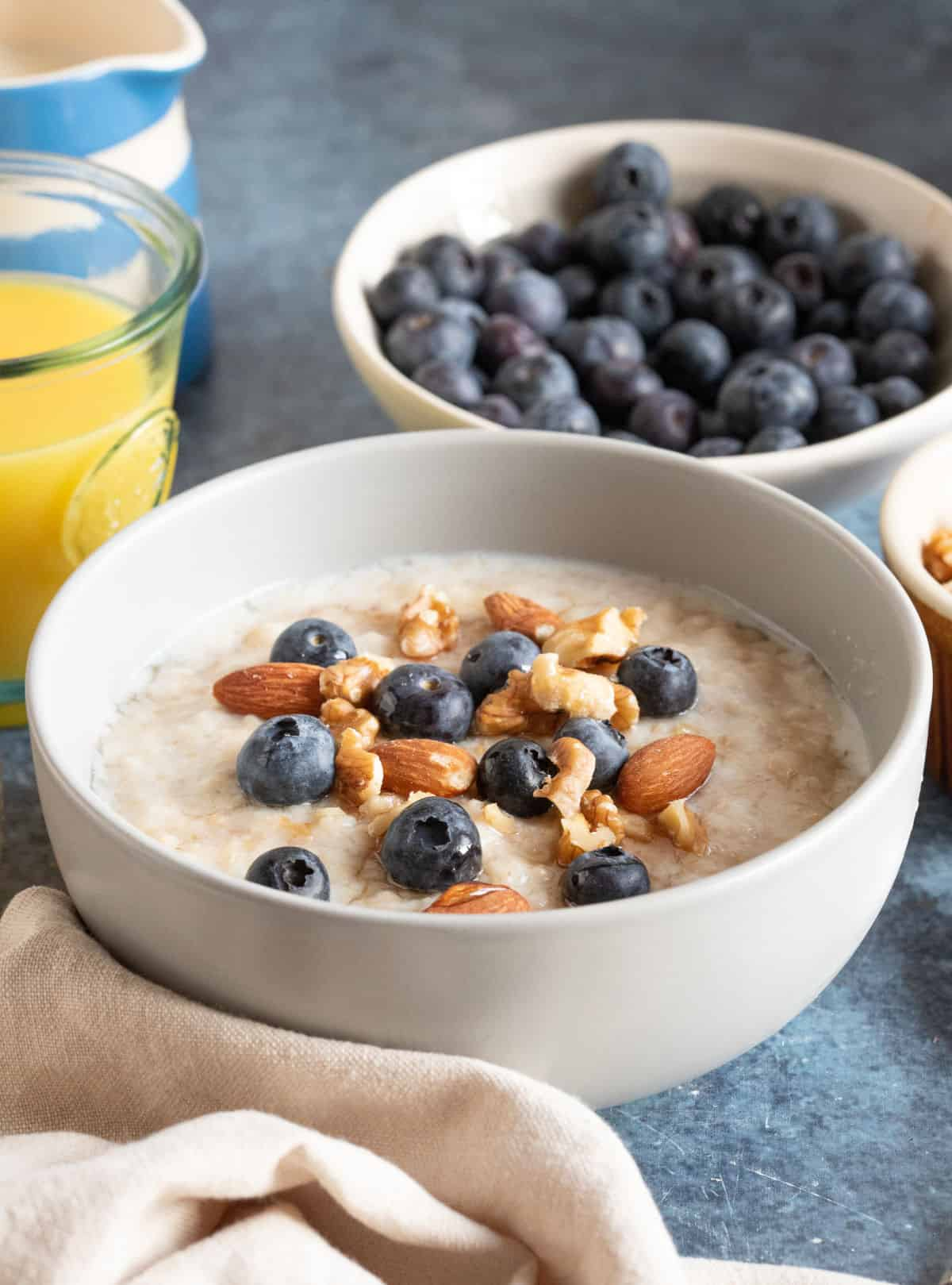 A bowl of slow cooker porridge with fruit and nuts.