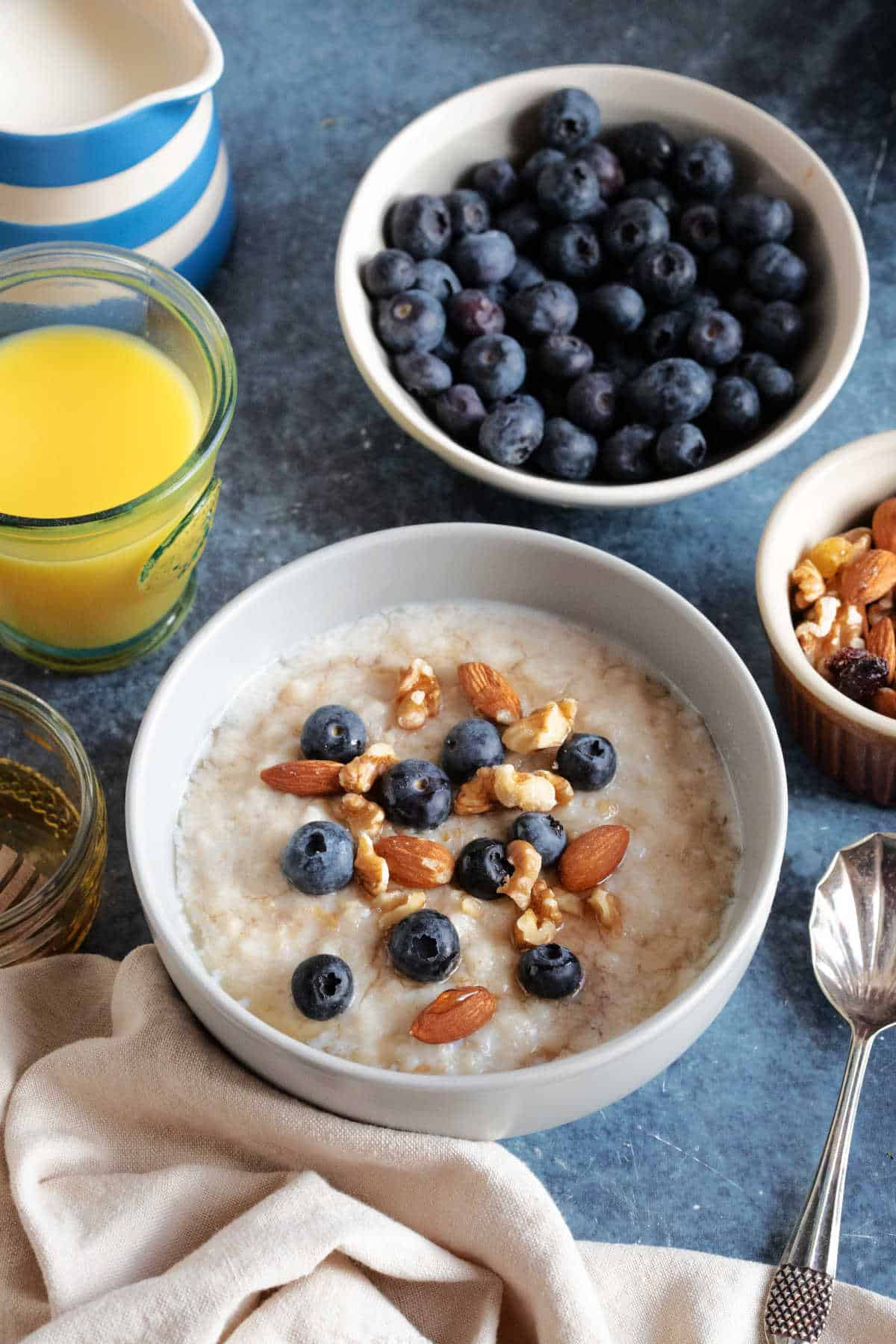 A bowl of slow cooker porridge with blueberries, nuts and honey.